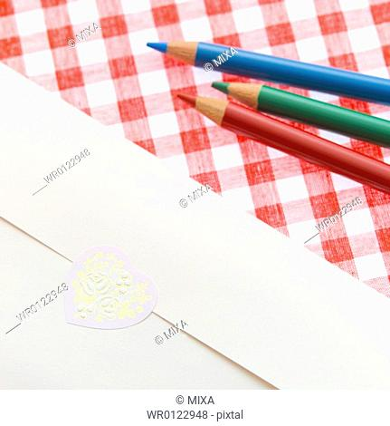 Colored pencils and envelope