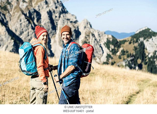 Austria, Tyrol, happy couple on a hiking trip in the mountains