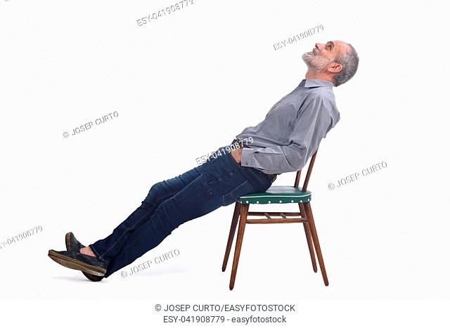 portrait of middle aged lying on a chair