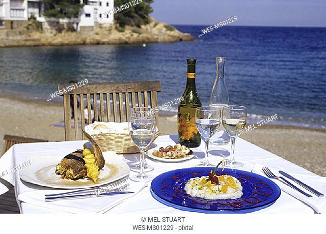 Table for two on sandy beach, Costa Brava, Catalonia, Spain