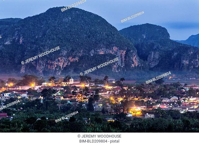 Aerial view of city rooftops lit up at night, Vinales, Pinar del Rio, Cuba