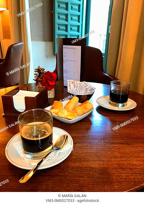 Two glasses of coffee in a cafeteria. Spain