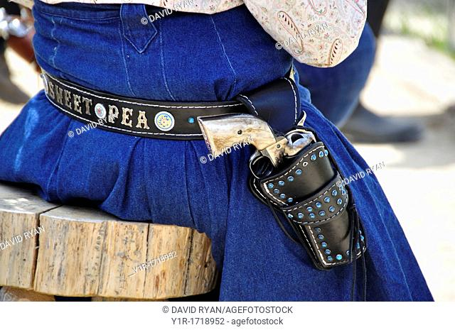 Woman wearing a Colt 45 at a fast draw competition, Pioneer Days Celebration in Idaho City, Idaho, USA