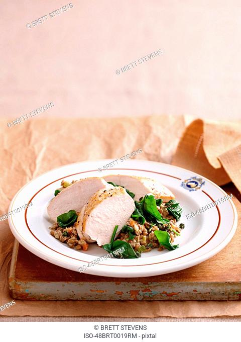 Plate of chicken and lentils