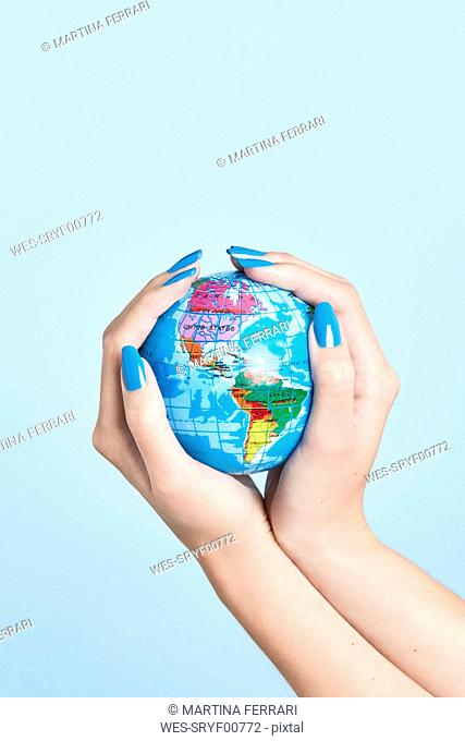 Close-up of woman's hands holding globe