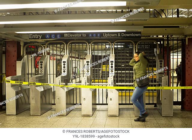 A commuter in New York passes a closed subway entrance at Penn Station on the IND subway line The Metropolitan Transportation Authority has instituted limited...