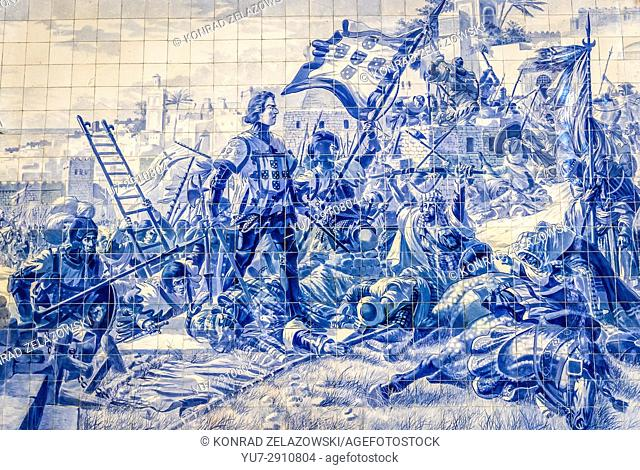Azulejo tiles panel historical scene depict Prince Henry the Navigator during the conquest of Ceuta in Sao Bento railway station in Porto, Portugal