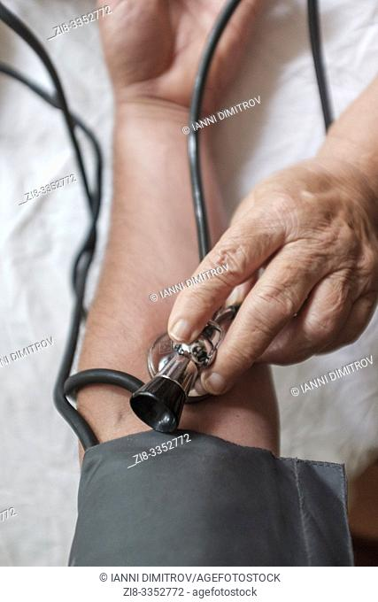 POV-Doctor checks patients blood pressure, selective focus
