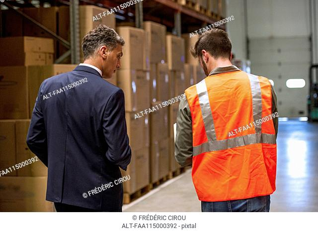 Worker and businessman discussing