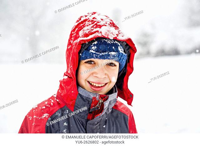Child under a snowfall