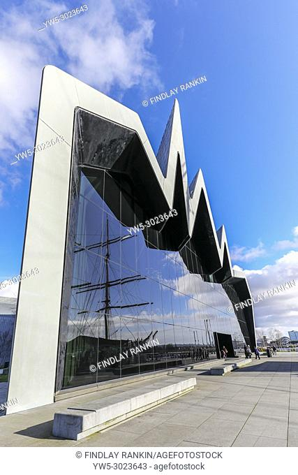 Front glass facade of the Transport museum with the reflection of the Glenlee, Anderston, River Clyde, Glasgow, Scotland