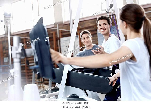 Physical therapists with man on treadmill