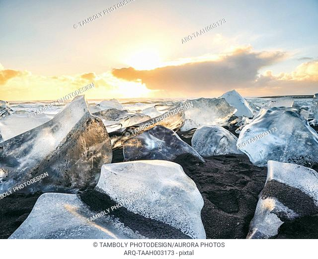 Beach on Eastern seaside of Jokulsarlon covered with big melted pieces of glacier, Jokulsarlon, South-East Iceland, Iceland