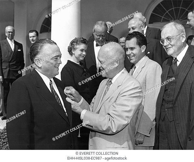 President Eisenhower presents the National Security Medal to FBI Director J. Edgar Hoover. Ceremony attended by a Cabinet group which included: Oveta Culp Hobby