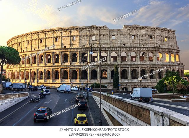 Coliseum in Rome and a street nearby, Italy, sunrise view