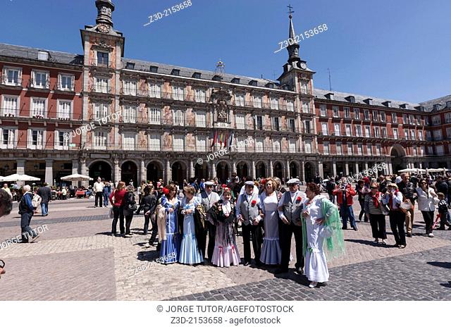 Group of people wearing traditional dress of Madrid in the Plaza Mayor of Madrid, Spain