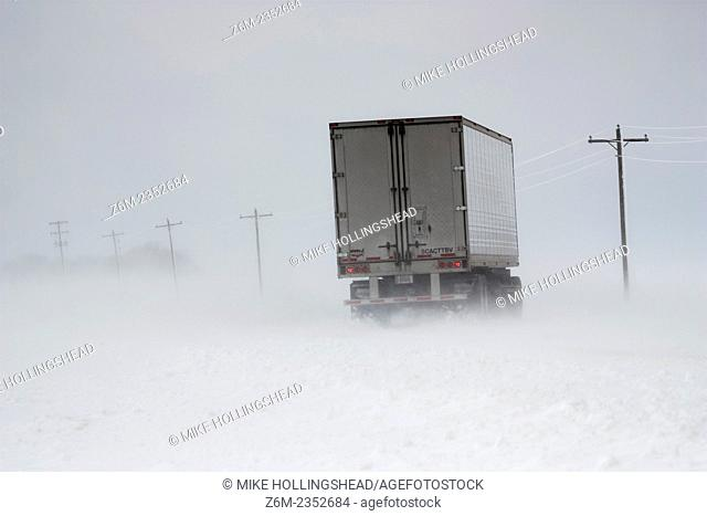 Semi begins to jackknife during an April blizzard in eastern Nebraska 2009. The driver regained control just before the oncoming cars crossed his path