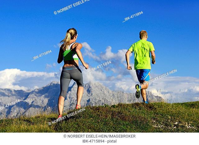 Hikers, Trail running on the Eggenalm, behind Loferer Steinberge, Reit im Winkl, Upper Bavaria, Bavaria, Germany