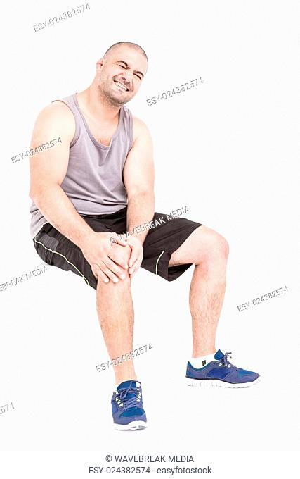 Athlete clutching knee in excruciating pain