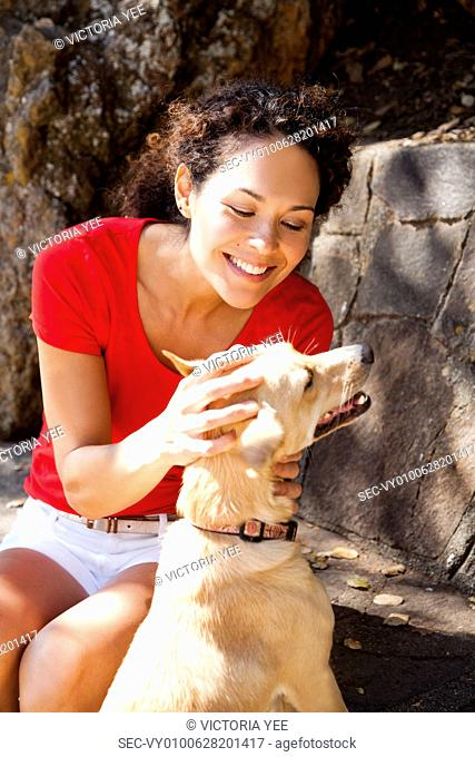 Woman with dog in backyard