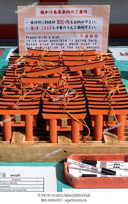 Ema wish plaques in the shape of orange torii gate, Fushimi Inari-taisha Shrine, Kyoto, Japan