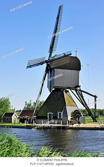 Wooden hollow post windmill at Kinderdijk, a UNESCO World Heritage Site at South Holland, the Netherlands