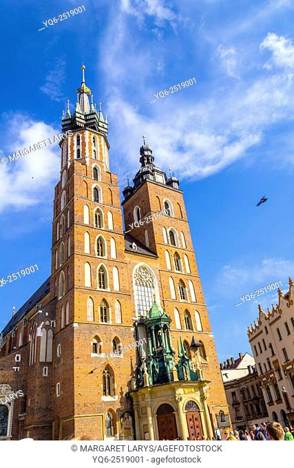 Mariacki church at the Main Square in Krakow, Poland, Europe. Spring 2015. Kraków also Cracow, or Krakow is the second largest and one of the oldest cities in...