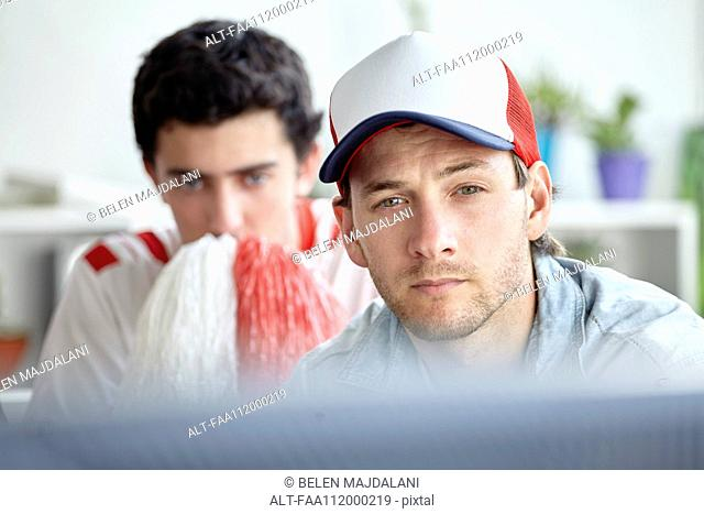 Sports fans watching match on TV