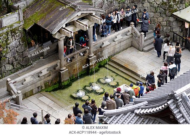 People drinking water for fortune and health from Otowa, sacred waterfall in Kiyomizu-dera, Buddhist temple. Otowa-no-taki, Kiyomizu-dera, Higashiyama, Kyoto