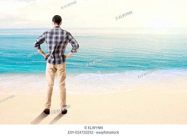 Man standing and looking the ocean, concept of relax, freedom etc