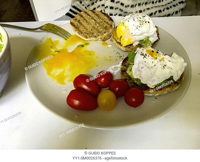 Berlin, Germany. Breakfast with Eggs and Tomatoes on a kitchen table in the morning
