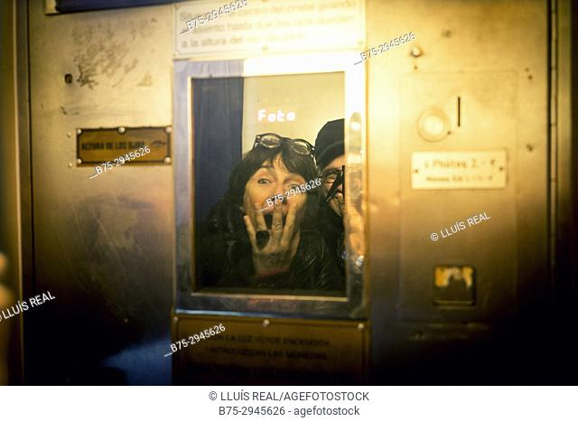 Woman showing expression of surprise inside photo booth. Berlin, Germany