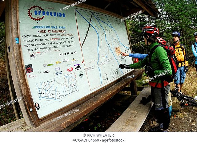 Checking the map on Sidewinder, Sunshine Coast trails, Gibsons, British Columbia, canada