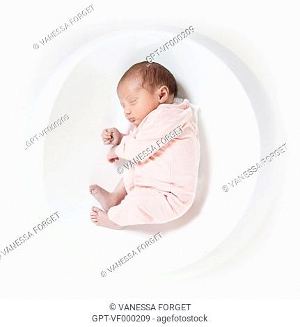 NEWBORN IN A FOETAL POSITION, THE START OF LIFE