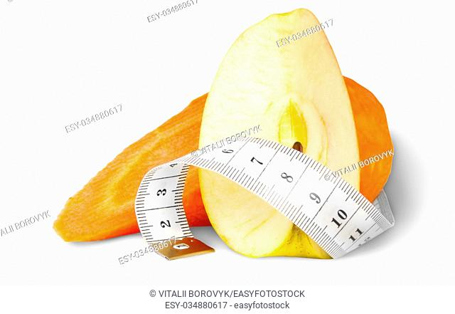 Slices Carrot With Apple And Sewing Measuring Isolated On White Background