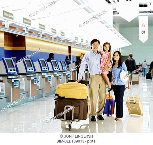Asian family posing in airport