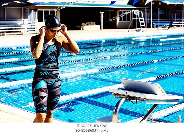 Swimmer preparing to go into pool