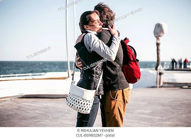 Couple hugging on sea waterfront, Odessa, Odeska Oblast, Ukraine