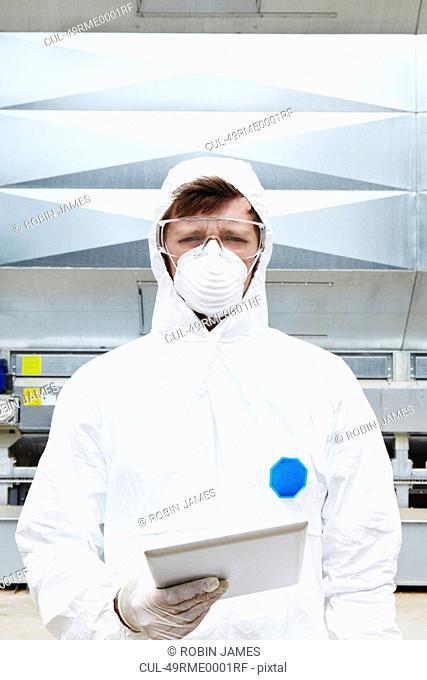 Lab worker wearing hazmat suit