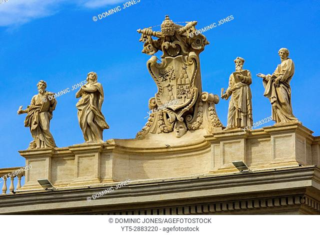 Four of the Saints and Alexander VII coat of arms which adorn the colonades at the Vatican, Vatican City, Europe