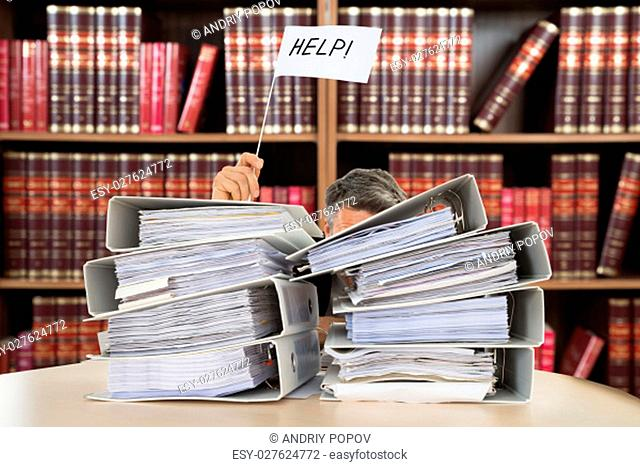 Stack Of Folders In Front Of Businessman Holding White Flag With Help Text