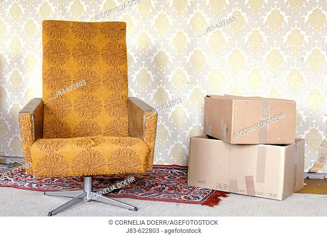 Armchair and move cardboards, Saxony, Germany