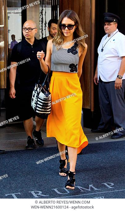 Jessica Alba, in Manhattan to promote her new film 'Sin City: A Dame to Kill For,' is carrying a Christian Louboutin handbag as she departs her SoHo hotel...