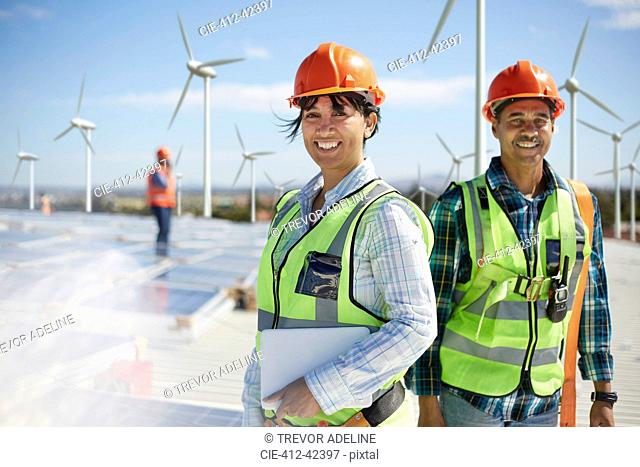 Portrait confident engineers at alternative energy power plant