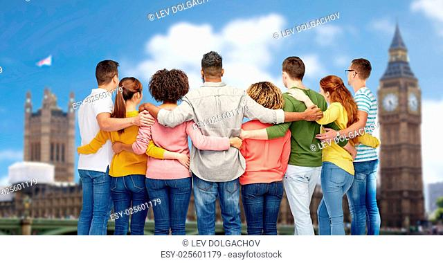 diversity, race, ethnicity and people concept - international group of men and women hugging over london city background