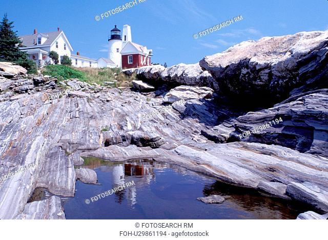 lighthouse, Maine, ME, Pemaquid Point, Bristol, Pemaquid Head Light reflects in a pool of water along the rocky coast of the Atlantic Ocean