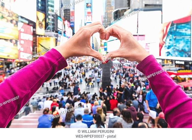USA, New York, heart-shaped hands on Times Square