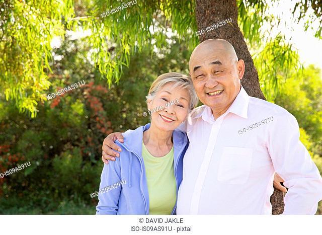 Portrait of senior couple, outdoors, smiling