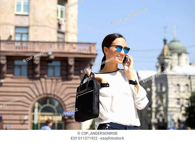 Beautiful business woman calling by phone