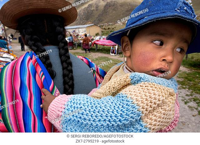 A woman with her little son at La Raya, which coincides with the highest point of the trail, 4313 meters. The Andean Explorer train Orient Express runs between...